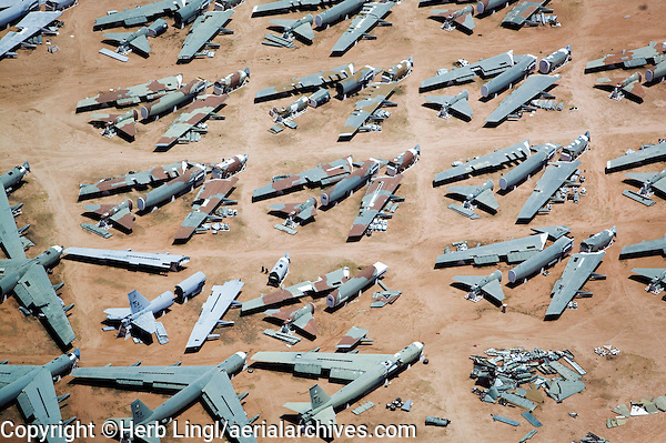 aerial photograph of Boeing B-52 aircraft in various stages of disassembly at the aircraft boneyard, Davis Monthan Air Force base, Tucson, Arizona