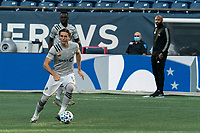 FOXBOROUGH, MA - SEPTEMBER 23: Luis Binks #5 of Montreal Impact brings the ball forward during a game between Montreal Impact and New England Revolution at Gillette Stadium on September 23, 2020 in Foxborough, Massachusetts.