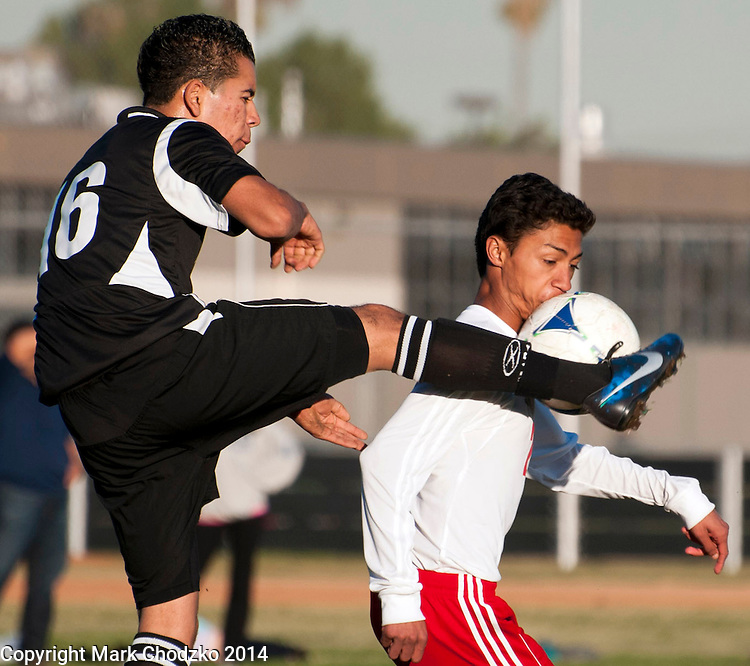 Tustin's Cristian Ceja gets called for a high kick and  Katella's Joel Batista gets a taste of the ball in Wednesday's game.<br />