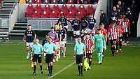 Referee Mr James Linington leads the two teams onto the pitch ahead of kick-off during Brentford vs Middlesbrough, Sky Bet EFL Championship Football at the Brentford Community Stadium on 7th November 2020