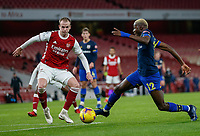 17th December 2020, Emirates Stadium, London, England;  Arsenals Rob Holding  challenges Southamptons Moussa Djenepo during the English Premier League match between Arsenal and Southampton