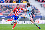 Jorge Resurreccion Merodio, Koke, of Atletico de Madrid (L) fights for the ball with Sergi Gomez Sola of RC Celta de Vigo (R) during the La Liga 2017-18 match between Atletico de Madrid and RC Celta de Vigo at Wanda Metropolitano on March 11 2018 in Madrid, Spain. Photo by Diego Souto / Power Sport Images