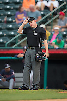 Home plate umpire Ryan Powers between innings of the game between the Rome Braves and the Hickory Crawdads at L.P. Frans Stadium on May 12, 2016 in Hickory, North Carolina.  The Braves defeated the Crawdads 3-0.  (Brian Westerholt/Four Seam Images)