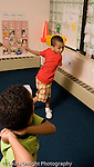 Preschool ages 3-5 two boys playing imaginary baseball pretend play vertical