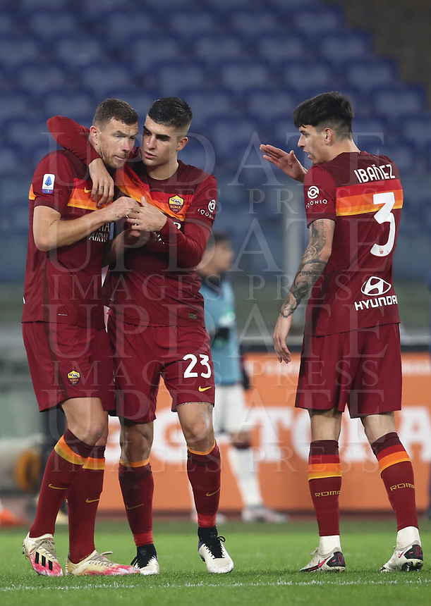 Football, Serie A: AS Roma - Cagliari calcio, Olympic stadium, Rome, December 23, 2020. <br /> Roma's captain Edin Dzeko (l) celebrates after scoring with his teammates Gianluca Mancini (c) and Roger Ibanez (r) during the Italian Serie A football match between Roma and Cagliari at Rome's Olympic stadium, on December 23, 2020.  <br /> UPDATE IMAGES PRESS/Isabella Bonotto