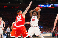 NEW YORK, NY - Sunday December 13, 2015: DaJuan Coleman (#32) of Syracuse guards Kassoum Yakwe (#14) of St. John's.  St. John's defeats Syracuse 84-72 during the NCAA men's basketball regular season at Madison Square Garden in New York City.