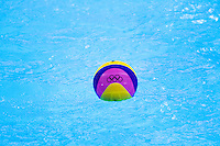 30 JUL 2012 - LONDON, GBR -The ball floats on the surface of the water during the London 2012 Olympic Games preliminary round water polo match between the USA and Hungary at the Olympic Park, Stratford, London, Great Britain (PHOTO (C) 2012 NIGEL FARROW)