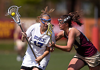 Morgan Miller (17) of Duke is fouled by Elizabeth Donovan (16) of Boston College during the first round of the ACC Women's Lacrosse Championship in College Park, MD.  Duke defeated Boston College, 17-6.
