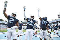 CHAPEL HILL, NC - OCTOBER 10: Dyami Brown #2 Tony Grimes #20, and Dae Dae Hollins #15 of North Carolina lead the fans in the team's fourth quarter chant during a game between Virginia Tech and North Carolina at Kenan Memorial Stadium on October 10, 2020 in Chapel Hill, North Carolina.