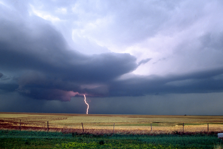 A wall cloud looms in the distance as a supercell thunderstorm approaches Gruver in the Texas Panhandle in May.