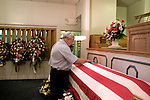 August 25, 2007. Kinston, NC.. A viewing of the coffin of Spc. Steven R. Jewell was held at Howard and Carter Funeral Home i Kinston, NC. Spc. Steven R. Jewell was killed in a helicopter crash  near the Iraqi city of Fallujah on August 14, 2007..  Jack Wisener, Spc. Jewell's stepfather, lays a hand on the coffin..