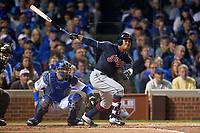 Cleveland Indians Jose Ramirez (11) hits a single in front of catcher Willson Contreras (40) in the second inning during Game 3 of the Major League Baseball World Series against the Chicago Cubs on October 28, 2016 at Wrigley Field in Chicago, Illinois.  (Mike Janes/Four Seam Images)