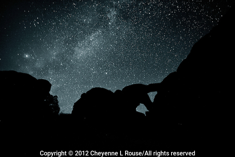 Milky Way Man - Arches NP, Utah. Night time shot of Double Arch with the Milky Way. It looks to me like a man bending over to squeeze out of this world and into the cosmos.