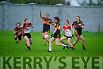 Megan O'Brien of Austin Stacks about to shoot despite the attempted block down by Leah Getkate of Corcha Duibhne in the Kerry Ladies Intermediate Football Championship.
