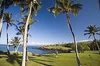 Man playing golf at an oceanfront resort on the leeward coast of the Big Island of Hawaii
