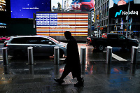 NEW YORK - NEW YORK - MARCH 24: A man walks at Times Square on March 24, 2021 in New York. With more people every day getting vaccinated transmission rates are dropping, arts an entertainment values should open at 33% capacity on April 2, as outdoor amusement parks will open at 25% capacity one week later (Photo by John Smith/VIEWpress)