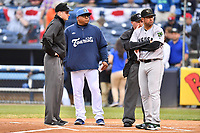 Umpire Nolan Early, Asheville Tourists manager Robinson Cancel, home plate umpire Evin Johnson and Augusta GreenJackets manager Carlos Valderrama (21) before a game against the Augusta GreenJackets at McCormick Field on April 4, 2019 in Asheville, North Carolina. The GreenJackets defeated the Tourists 9-5. (Tony Farlow/Four Seam Images)
