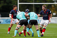 Luke Frost of London Scottish is tackled during the Championship Cup match between London Scottish Football Club and Nottingham Rugby at Richmond Athletic Ground, Richmond, United Kingdom on 28 September 2019. Photo by Carlton Myrie / PRiME Media Images