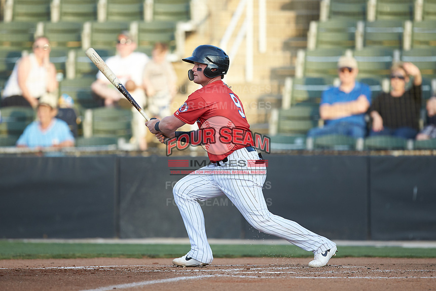 Evan Skoug (9) of the Piedmont Boll Weevils follows through on his swing against the Hickory Crawdads at Kannapolis Intimidators Stadium on May 3, 2019 in Kannapolis, North Carolina. The Boll Weevils defeated the Crawdads 4-3. (Brian Westerholt/Four Seam Images)