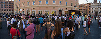 """This photo is an artificial stitch of 4 frames together. It can contain photographic mistakes.<br /> <br /> Rome, 27/07/20. Today, hundreds of people, NGO's (ONG) representatives, actors and politicians gathered in Piazza San Silvestro (near Italian Parliament) to protest (1.) against the dramatic situation in Libya - erupted in a civil war between the GNA (2.) and the forces of General Khalifa Belqasim Haftar - and to protest against the inhumane conditions of migrant people trapped in legal and illegal prisons in Libya. The aim of the demo was to call the Italian Government to stop funding the """"Libyan Coast Guard"""" and to immediately help and free People in Libya throughout """"Humanitarian Corridors"""", and give them the protection they are entitled of by the International Human Rights Conventions. <br /> From the organisers Facebook event page: «[…] we meet to ask the Italian Government and the European States to stop funding the so-called Libyan coast guard, to close and evacuate the detention centres by transferring migrants out of Libya and to promote corridors to help people on the run find protection without endangering their lives. The men, women and children who take the sea from the Libyan coast flee from situations of extreme misery, despotic regimes, tribal persecutions, ethnic conflicts, wars and environmental catastrophes. And in Libya they are subjected to violence, extortion, detention, torture, rape and torture. A few days ago, on July 16, the Chamber of Deputies [Of the Italian Parliament, ndr] for the fourth consecutive year approved the financing of the Italian mission in Libya, which provides financial support for the so-called Libyan coastguard and training and training of its members. […] The mobilization will be accompanied by readings by Ascanio Celestini, Valentina Carnelutti, Fabrizio Gifuni and Sonia Bergamasco […]».<br /> <br /> Footnotes & Links:<br /> 1. http://bit.do/fG3Eu<br /> 2. 07.05.19 Prime Minister of Libya Fayez al-Serraj Met Ital"""