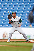Fort Wayne TinCaps first baseman Trae Santos (16) stretches for a throw during a game against the Lake County Captains on May 20, 2015 at Classic Park in Eastlake, Ohio.  Lake County defeated Fort Wayne 4-3.  (Mike Janes/Four Seam Images)