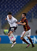 Calcio, Serie A: Roma vs Bologna. Roma, stadio Olimpico, 11 aprile 2016.<br /> Bologna's Sergio Floccari, left, is challenged by Roma's Miralem Pjanic during the Italian Serie A football match between Roma and Bologna at Rome's Olympic stadium, 11 April 2016.<br /> UPDATE IMAGES PRESS/Isabella Bonotto