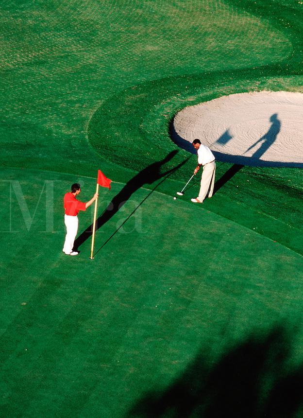 Two men golfing.