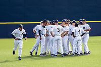 Michigan Wolverines pregame huddle before the NCAA baseball game against the Eastern Michigan Eagles on May 8, 2019 at Ray Fisher Stadium in Ann Arbor, Michigan. Michigan defeated Eastern Michigan 10-1. (Andrew Woolley/Four Seam Images)