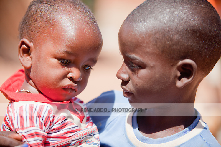 A Fulani boy holds his younger brother in Djibo, northern Burkina Faso.
