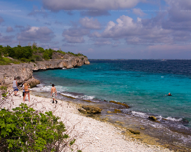 "Diving Bonaire, Netherland Antilles -- Divers and sunbathers mix at the beach. (""Ol' Blue"" dive site)."
