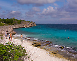 "Diving Bonaire, Netherland Antilles -- Divers and sunbathers mix at the beach. (""Ol' Blue"" dive site)."