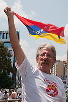 Venezuela: Caracas,18/02/14 <br /> A man wave a venezuelan flag during the rally in support of Leopoldo López, in Plaza Brion in Chacaíto, Caracas. Lopez was then handed to the National Guard, because the government had issued an arrest warrant against him responsible for the violence of the protest 12F, where two students and a member of a pro-government paramilitary group died.  <br /> Adolfo Acosta/Archivolatino