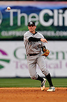 Second baseman Daniel Seeba (5) of the USC Upstate Spartans throws out a runner at first in a game against the Furman University Paladins on Tuesday, March 4, 2013, at Fluor Field at the West End in Greenville, South Carolina. Furman won, 13-1. (Tom Priddy/Four Seam Images)