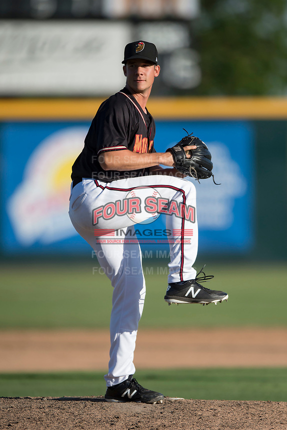 Modesto Nuts relief pitcher Colin Rodgers (45) prepares to deliver a pitch during a California League game against the San Jose Giants at John Thurman Field on May 9, 2018 in Modesto, California. San Jose defeated Modesto 9-5. (Zachary Lucy/Four Seam Images)