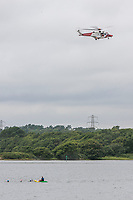 BNPS.co.uk (01202 558833)<br /> Pic: MaxWillcock/BNPS<br /> Date taken: 27/06/2021<br /> <br /> Pictured: The HM Coastguard helicopter from Lee-on-the-Solent.<br /> <br /> The search for a heroic teenager who is feared to have drowned after rescuing his nieces and nephews from a ferocious riptide is continuing today.<br /> <br /> Calum Osborne-Ward, 18, was swept away in front of his family moments after lifting the last of a group of children into a rescue boat.<br /> <br /> The youngsters had been swimming and playing in relatively shallow water close to Black Bridge at Rockley Point in Poole Harbour, Dorset, when they were dragged away by the fast flowing tide.