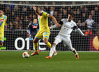 Swansea, UK. Thursday 20 February 2014<br /> Pictured L-R: Gokhan Inler of Napoli is challenged by Pablo Hernandez of Swansea<br /> Re: UEFA Europa League, Swansea City FC v SSC Napoli at the Liberty Stadium, south Wales, UK
