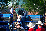 July 7, 2011 - Calgary, Alberta, Canada - Prince William climbs over the pen at the Calgary Stampede grounds in front of BMO centre to watch a rodeo demonstration. Calgary is the last Canadian stop of the British Royal Tour. Photo by Jimmy Jeong / Rogue Collective
