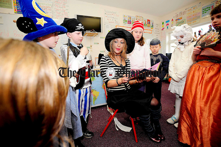 1st and 2nd class teacher Martina O'Leary as character The Wicked Witch of the East reading to her class during Bookweek at Lahinch National School.Pic Arthur Ellis.