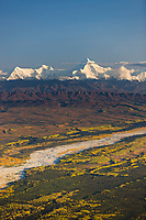 Little delta river flows out of the Alaska Range mountains, mount Hayes, the prominent peak, Interior, Alaska.