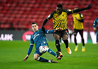 Kenny McLean of Norwich City and Ismaïla Sarr of Watford during the Sky Bet Championship behind closed doors match played without supporters with the town in tier 4 of the government covid-19 restrictions, between Watford and Norwich City at Vicarage Road, Watford, England on 26 December 2020. Photo by Andy Rowland.