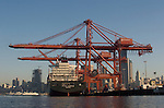 Seattle, Container ship, container cranes, China trade; Seattle skyline; Port of Seattle, Elliott Bay, Puget Sound, Washington State, Pacific Northwest, USA, North America,