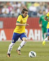 Brazil midfielder Bernard  (20) brings the ball forward.  In an international friendly, Brazil (yellow/blue) defeated Portugal (red), 3-1, at Gillette Stadium on September 10, 2013.