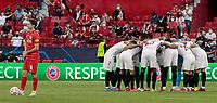 14th September 2021; Sevilla, Spain: UEFA Champions League football, Sevilla FC versus RB Salzburg; Sevilla players huddle pre-game