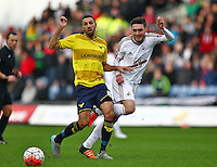 Matt Grimes of Swansea and Liam Sercombe of Oxford United   during the Emirates FA Cup 3rd Round between Oxford United v Swansea     played at Kassam Stadium  on 10th January 2016 in Oxford