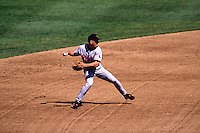 OAKLAND, CA - Cal Ripken Jr. of the Baltimore Orioles makes a play at shortstop during a game against the Oakland Athletics at the Oakland Coliseum in Oakland, California in 1996. Photo by Brad Mangin