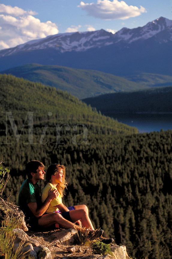 Couple enjoying scenic view at sunset.