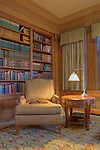 Library with over stuffed chair, bookcases and reading lamp.  Dating to 1927, the Masonic Retirement Center, locally known as the Masonic Home, in Des Moines, Washington is now an elegant event center available for rental.  In the historic Zenith neighborhood of the city of Des Moines. Please conact douglasorton@comcast.net regarding licensing of this image.