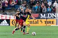 FOXBOROUGH, MA - AUGUST 4: Adam Buksa #9 of New England Revolution on the attack as Matt LaGrassa #22 of Nashville SC defends during a game between Nashville SC and New England Revolution at Gillette Stadium on August 4, 2021 in Foxborough, Massachusetts.