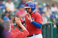 Buffalo Bisons first baseman Rowdy Tellez (21) high fives teammates during a game against the Indianapolis Indians on August 17, 2017 at Coca-Cola Field in Buffalo, New York.  Buffalo defeated Indianapolis 4-1.  (Mike Janes/Four Seam Images)