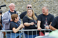 Pictured: The parents of Gareth Thomas Yvonne (2nd L), Barry (L) and husband Stephen (R). Sunday 15 September 2019<br /> Re: Ironman triathlon event in Tenby, Wales, UK.